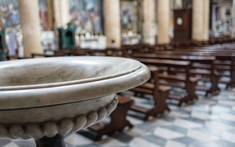 baptismal-font-in-front-of-empty-church
