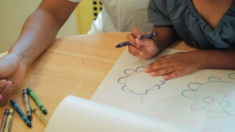 parent-and-child-drawing-with-crayons