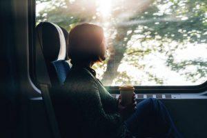 woman-looking-out-train-window