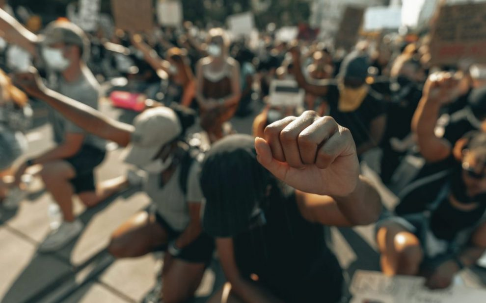 people-kneeling-and-raising-fists-in-protest