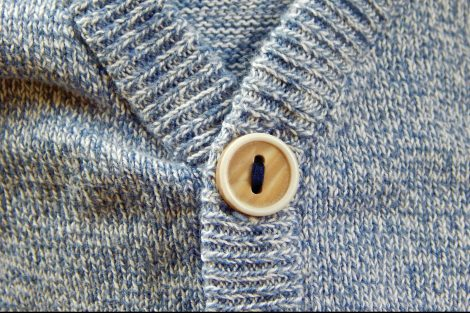 button-on-a-grey-knit-sweater