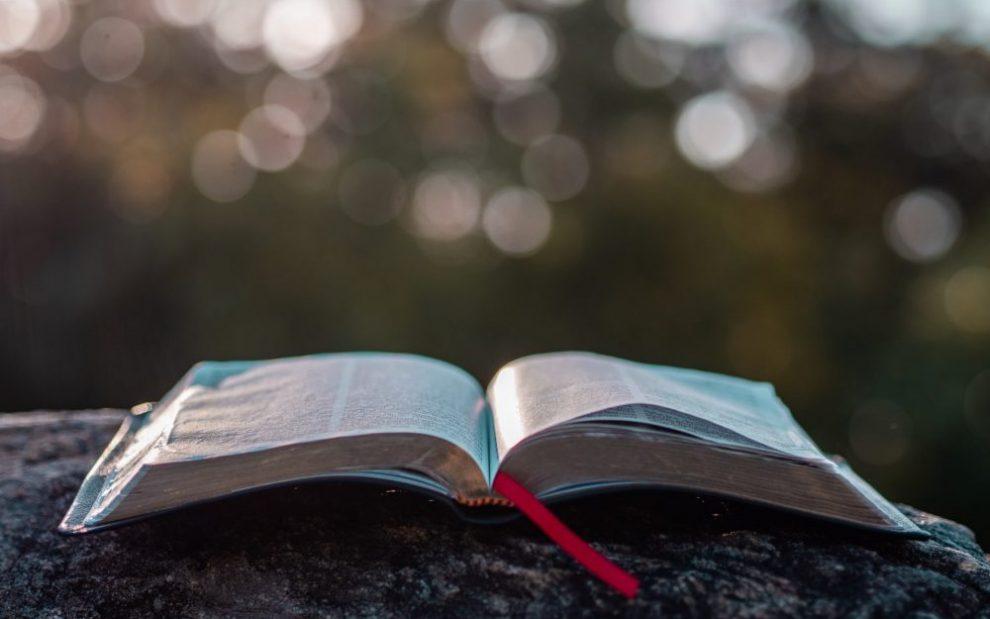 open-bible-sitting-on-stone