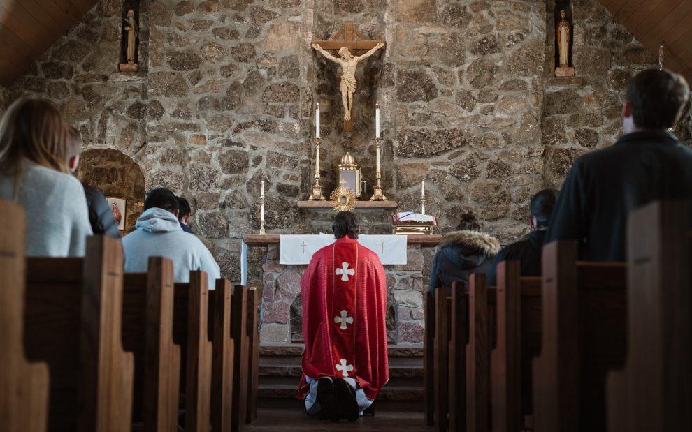priest-kneeling-before-altar