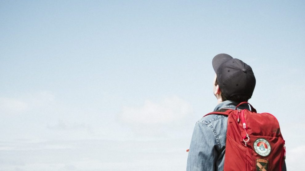 man-looking-out-into-blue-sky