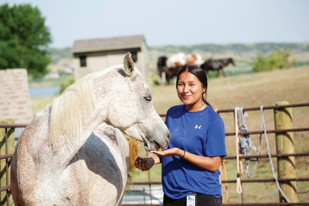 girl-with-horse-at-st-josephs-indian-school