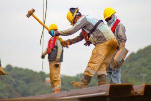 construction-worker-swinging-hammer