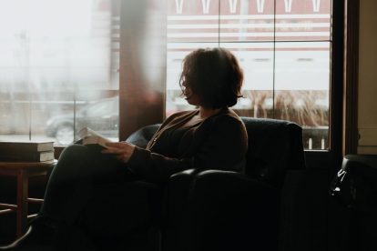 woman-reading-beside-window