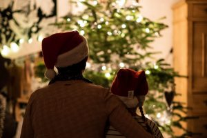 parent-and-child-in-front-of-christmas-tree