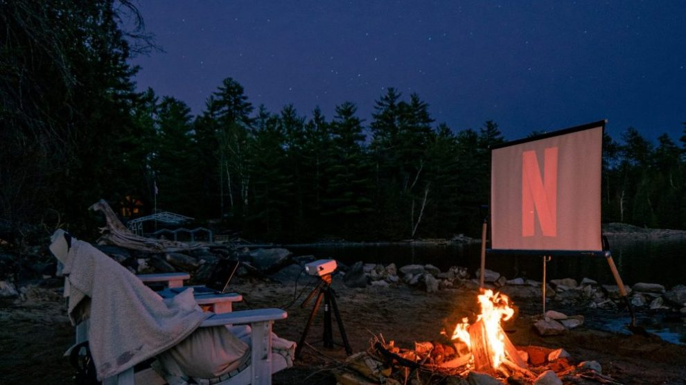 bonfire-with-projector-screen-playing-netflix