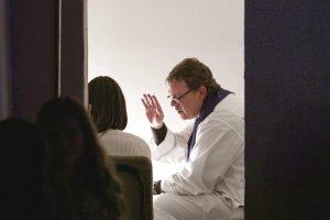 priest-giving-sacrament-of-reconciliation