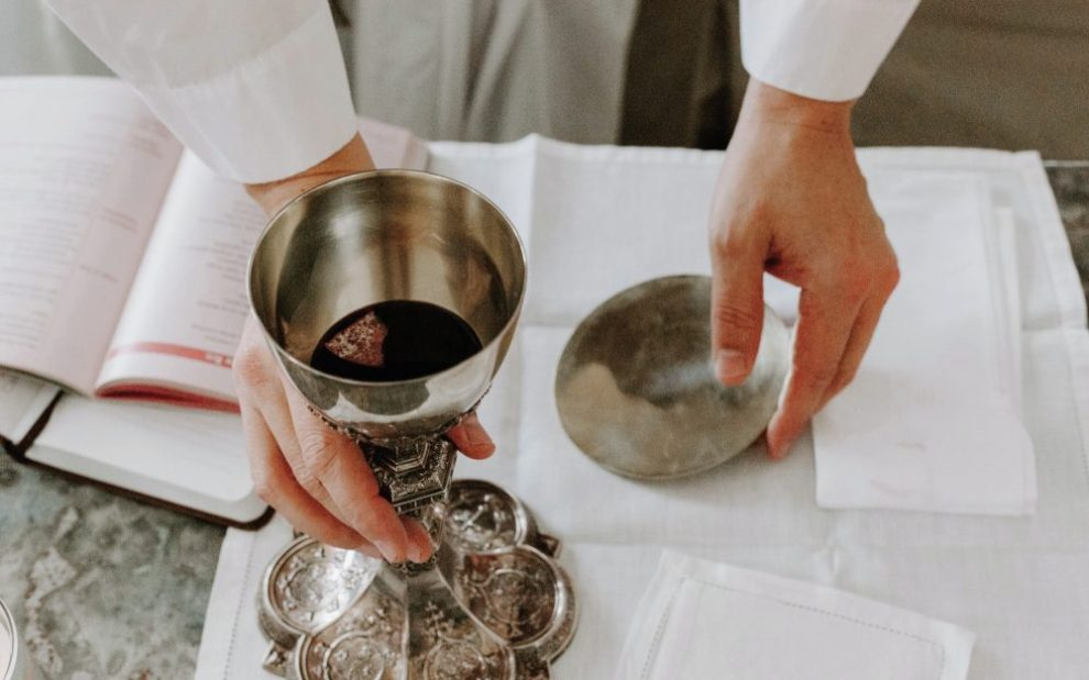 priest-preparing-eucharist