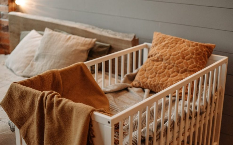 empty-crib-with-blankets-and-pillows